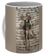 A U.s. Police Officer Contractor Leans Coffee Mug