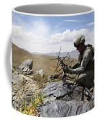 A U.s. Soldier Sets Up A Portable Coffee Mug