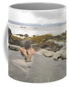 A Woman Enjoys A Hot Spring Coffee Mug by Taylor S. Kennedy