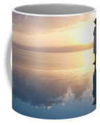 A Woman Enjoys The Warm Sun On The Edge Coffee Mug by Taylor S. Kennedy