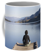 A Woman Enjoys Yoga And Relaxation Coffee Mug by Taylor S. Kennedy