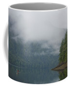 A Woman Kayaks Along A Quiet Inlet Coffee Mug by Taylor S. Kennedy