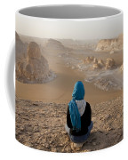 A Woman Sits Quietly On A Cliff Looking Coffee Mug