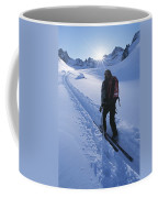 A Woman Skiing In The Selkirk Coffee Mug by Jimmy Chin