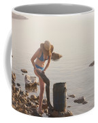 A Woman Smears Therapeutic Dead Sea Mud Coffee Mug by Taylor S. Kennedy