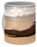 A Woman Sunbathes On The Beach Coffee Mug