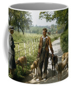 A Woman Talks With A Man Walking Racing Coffee Mug by B. Anthony Stewart