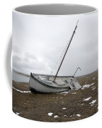 A Wooden Sailboat Is Beached Coffee Mug
