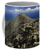 Abutting The Clouds, Hikers Rest Atop Coffee Mug
