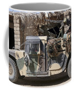 Afghan National Army Soldiers Prepare Coffee Mug