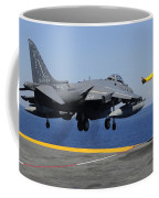 Airman Gives The Thumbs-up Signal As An Coffee Mug