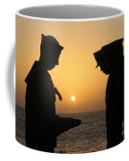 Airman Presents Commanding Officer Coffee Mug
