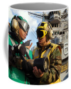 Airman Receives Proper Fire Fighting Coffee Mug by Stocktrek Images