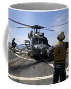 Airman Signals To An Mh-60s Sea Hawk Coffee Mug
