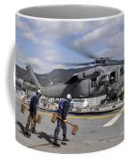 Airmen Prepare To Chock And Chain An Coffee Mug
