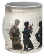 An Afghan Police Student Prepares Coffee Mug