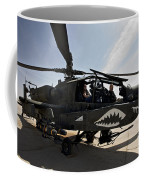 An Ah-64d Apache Helicopter Parked Coffee Mug