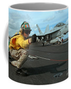 An Airman Gives The Signal To Launch An Coffee Mug