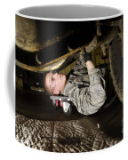 An Airman Inspects The Undercarriage Coffee Mug by Stocktrek Images