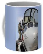 An Airman Makes A Final Look Over An Coffee Mug