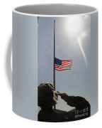 An Airman Salutes The American Flag Coffee Mug