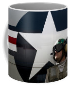 An Airman Stands In Front Of A C-2a Coffee Mug