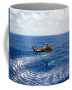 An Astronaut Is Rescued By A U.s Coffee Mug