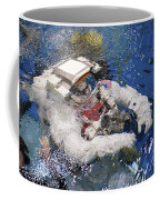 An Astronaut Is Submerged In The Water Coffee Mug by Stocktrek Images