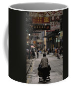 An Elderly Woman Pushes A Cart Coffee Mug by Justin Guariglia