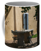 An Empty Table Awaits Residents Coffee Mug by Heather Perry
