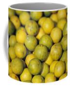 An Enticing Display Of Lemons Coffee Mug by Jason Edwards