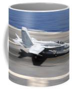 An Fa-18e Super Hornet Lands Aboard Uss Coffee Mug