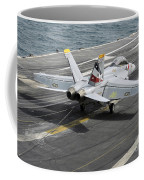 An Fa-18f Super Hornet Traps An Coffee Mug