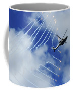 An Hh-60h Sea Hawk Helicopter Releases Coffee Mug