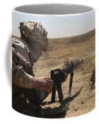 An Iraqi Army Soldier Prepares To Fire Coffee Mug