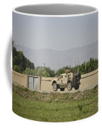 An M-atv Driving Towards Aliabad Coffee Mug