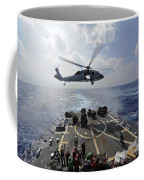 An Mh-60r Sea Hawk Transfers Supplies Coffee Mug