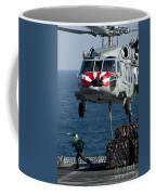 An Mh-60s Sea Hawk Picks Up Pallets Coffee Mug