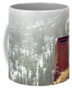 An Outhouse Perches On A Hillside Coffee Mug by Rex A. Stucky