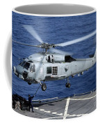 An Sh-60b Seahawk Helicopter Performs Coffee Mug