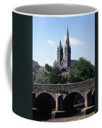 Arch Bridge Across A River With A Coffee Mug