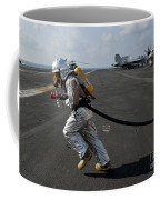 Aviation Boatswain's Mate Carries Coffee Mug