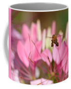 Bee In Flight Over Cleome Flower Coffee Mug