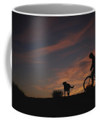 Bicyclist And Pet Silhouetted Coffee Mug