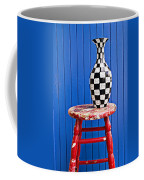 Blach And White Vase On Stool Against Blue Wall Coffee Mug