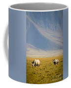 Black Rhinos Walking Across The Crater Coffee Mug