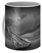 Boat Stranded On A Beach Covered By Menacing Storm Clouds Coffee Mug
