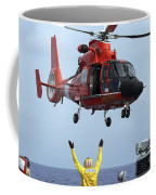 Boatswain Mate Directs A Hh-65a Dolphin Coffee Mug by Stocktrek Images