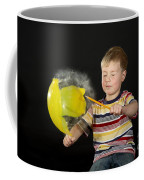 Boy Popping A Balloon Coffee Mug