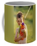 Boy Spraying Water Gun Coffee Mug